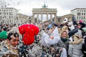 People take part in pillow fight flashmob at Brandenburg Gate that in Berlin